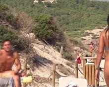Tiny sling bikini on the beach