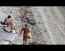 Couple fucked on a public beach while as people walked near