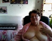 naughty granny flashing her big tits on cam