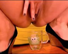 Naughty girl cums in cup and eats it