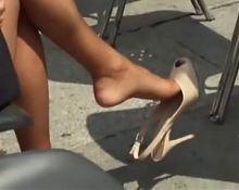 Blond milf shoeplay heels in park